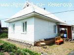Продается бревенчатый дом в п. Крапивинский.